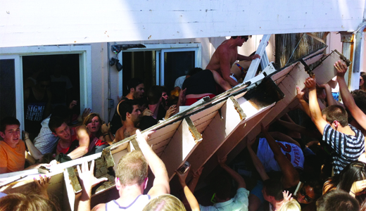 Deltopia celebrations and landlords' alleged negligent maintenance led to the collapse of a balcony, severely injuring four students. Two victims have filed lawsuits against the property managers of 6643 Del Playa Drive.