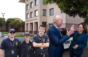 three CSOs standing next to Kamala Harris and Joe Biden
